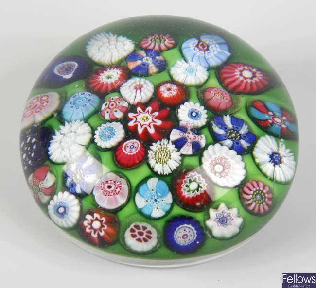 A Clichy green ground spaced millefiori paperweight