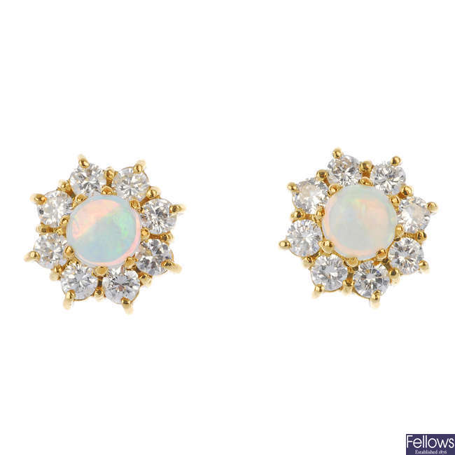 A pair of 18ct gold opal and diamond cluster ear studs.