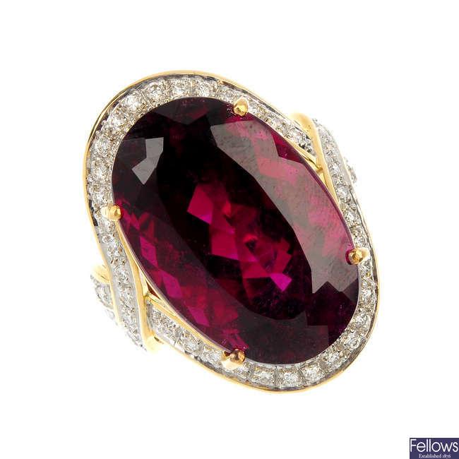 An 18ct gold tourmaline and diamond dress ring.