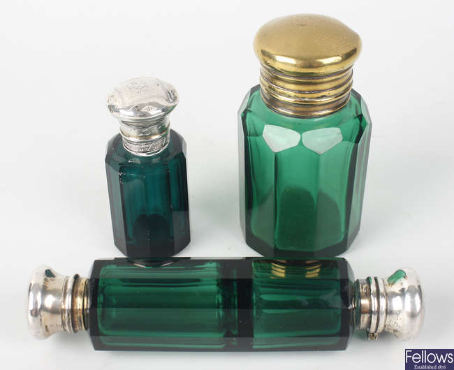 Four green glass scent phials