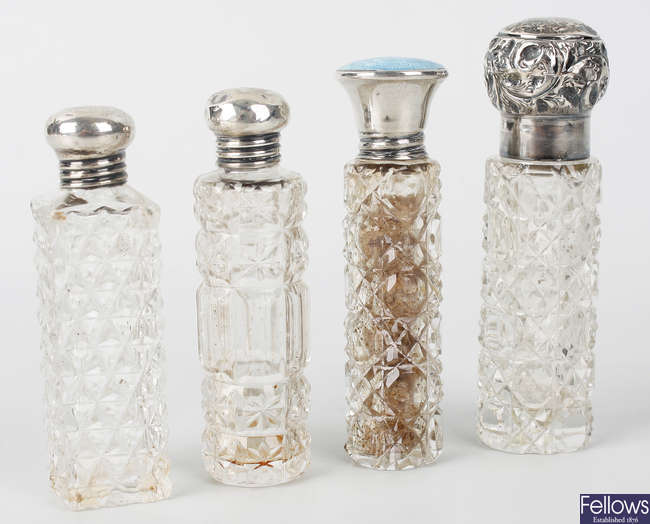 Four clear glass scent bottles