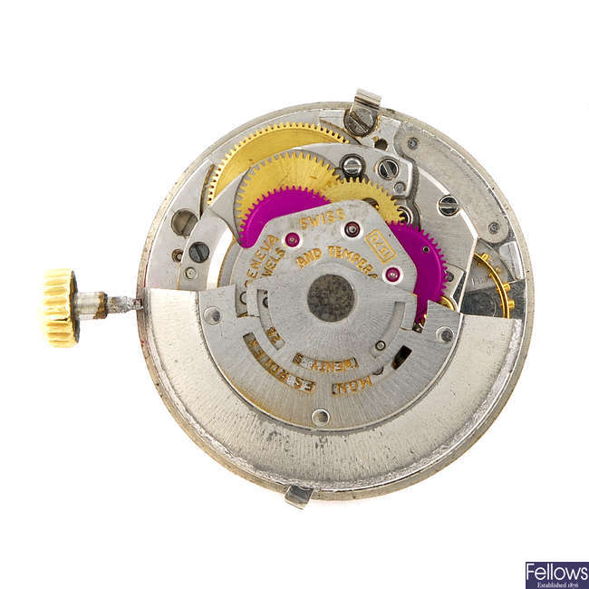 A Rolex movement and dial.