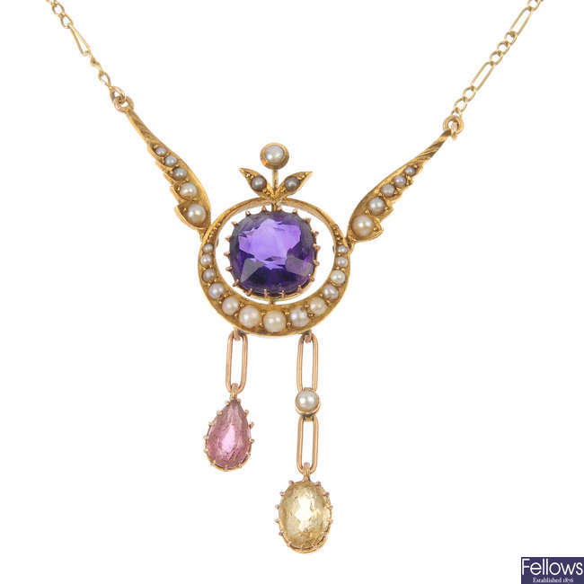 An early 20th century 18ct gold gem-set and seed pearl necklace.