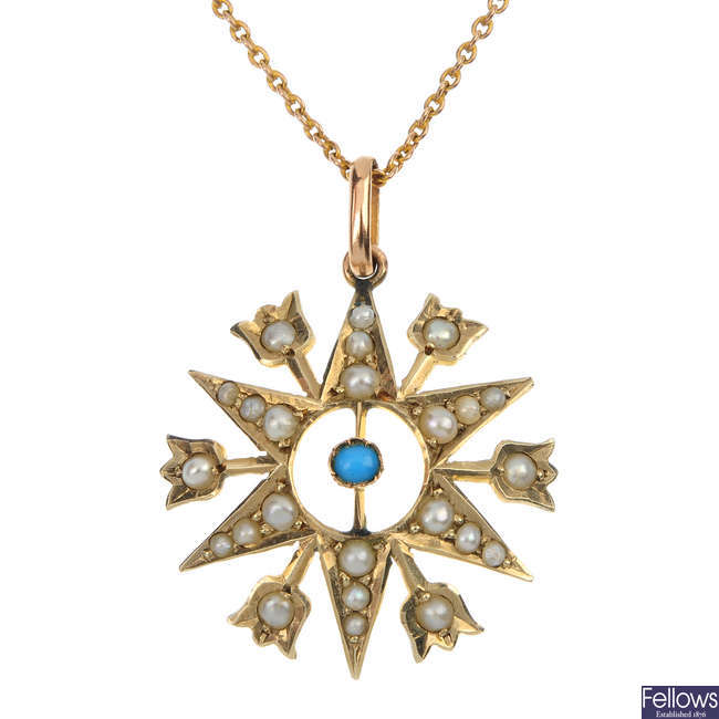 An early 20th century turquoise and split pearl pendant.