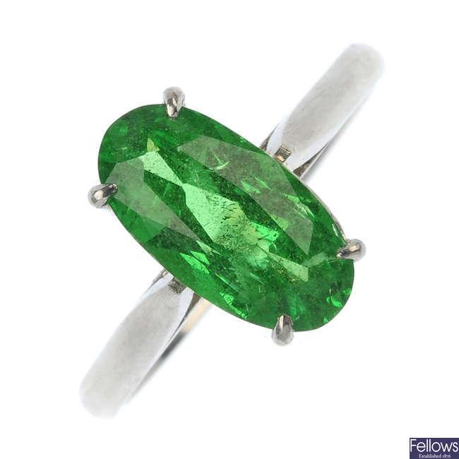 A platinum tsavorite garnet single-stone ring.