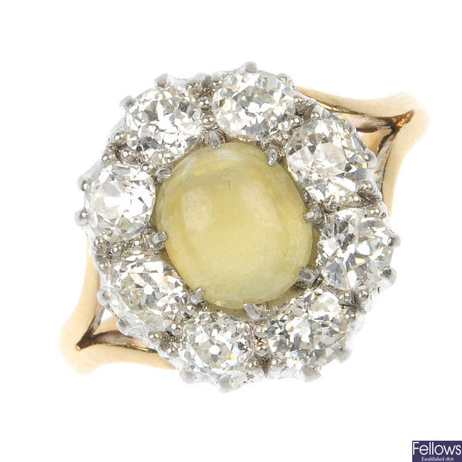 A late 19th century 15ct gold cat's-eye chrysoberyl and diamond cluster ring.