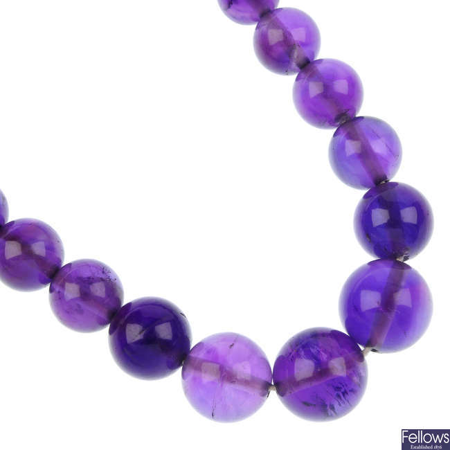 An amethyst bead single-strand necklace.