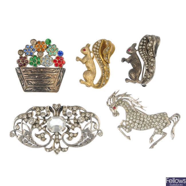 A selection of eight items of paste jewellery.