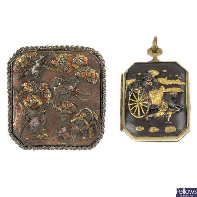A Shakudo brooch and locket.
