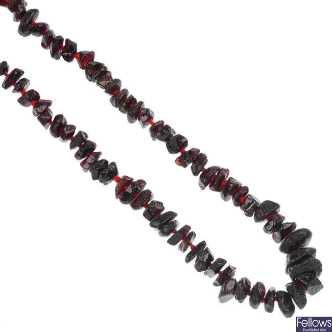 A selection of three garnet bead single-strand necklaces