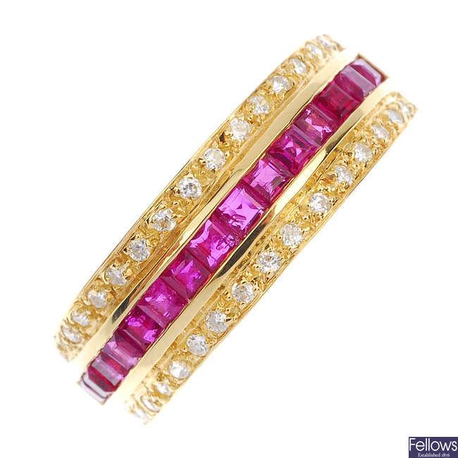 A ruby and diamond three-row ring.