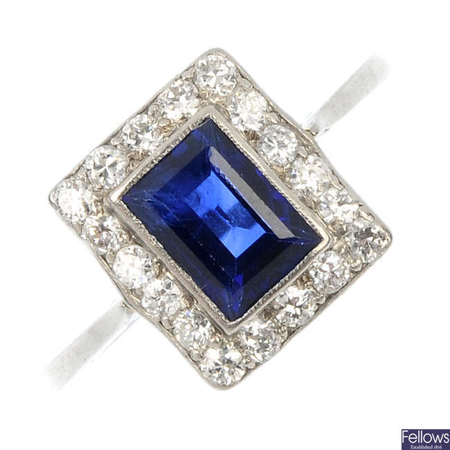 A mid 20th century platinum sapphire and diamond cluster ring.
