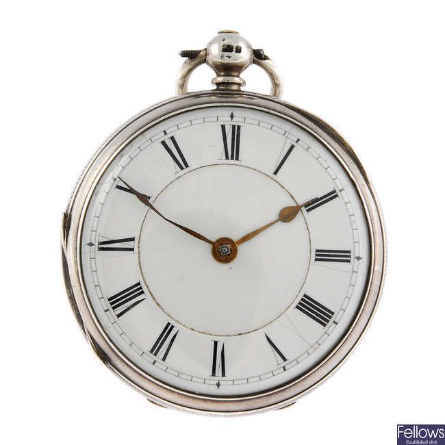 An open face pocket watch together with a silver chain and fob.