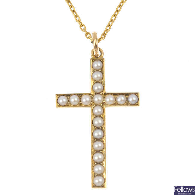 An early 20th century 15ct gold split pearl cross pendant.