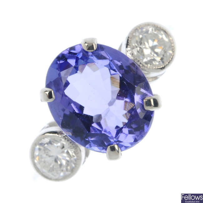 A tanzanite and diamond three-stone ring.
