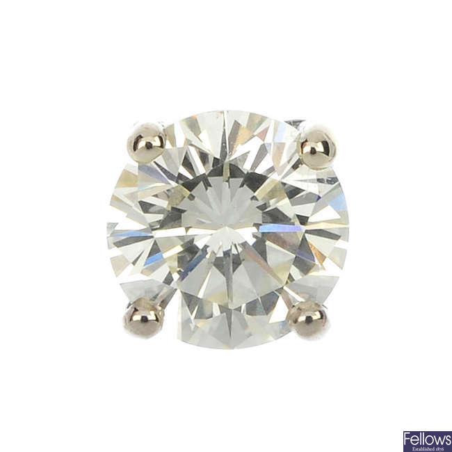 A brilliant-cut diamond single ear stud.