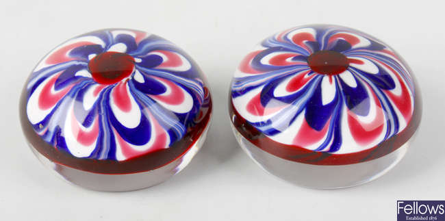 A matched pair of marbrie Old English paperweights