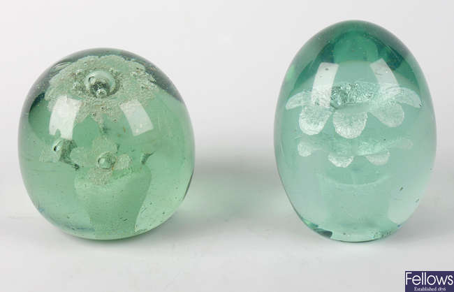 Two Victorian green glass dump paperweights
