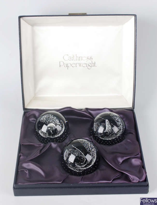 A cased set of three Caithness paperweights