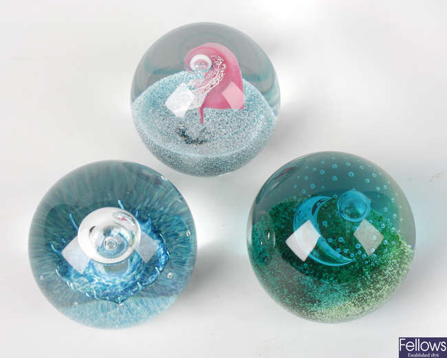 A collection of four limited edition Caithness paperweights