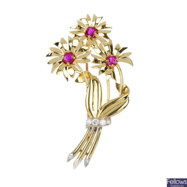A ruby and diamond floral brooch.