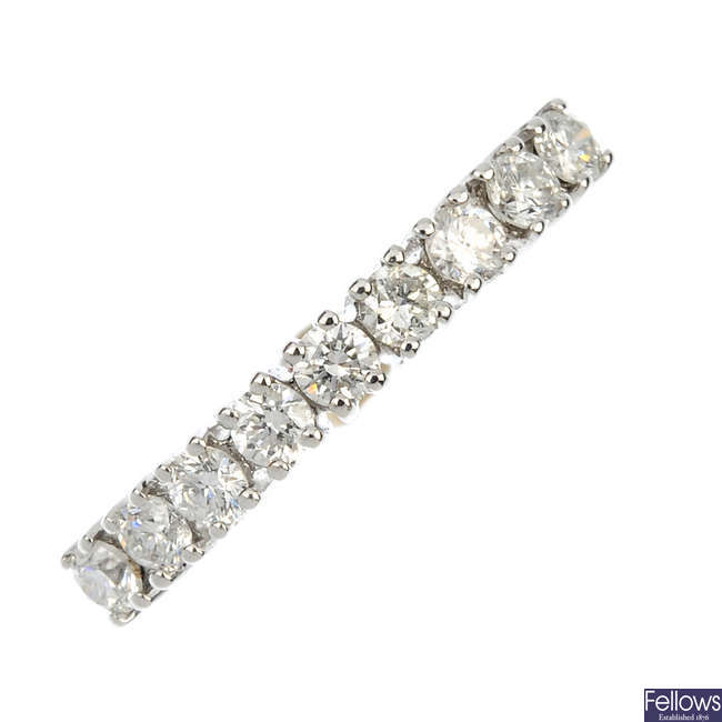 A diamond half-circle eternity ring.