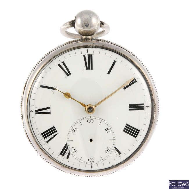 A silver open face pocket watch.
