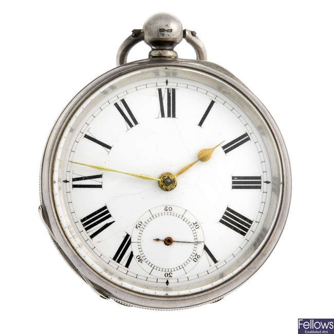 A silver open face pocket watch by Waltham and a white metal pocket watch.