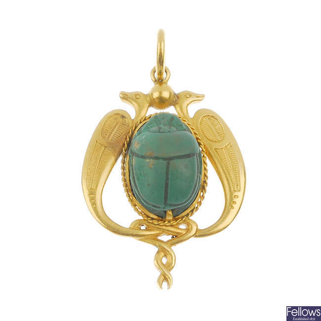An early 20th century 18ct gold Egyptianesque ceramic scarab pendant.