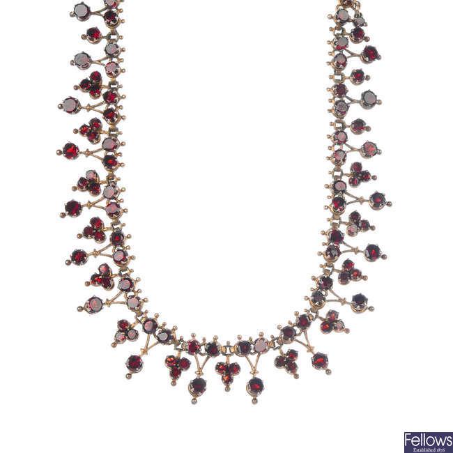 A late 19th century garnet fringe necklace.