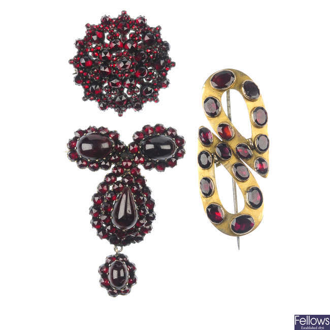 Three late 19th century garnet and paste brooches.