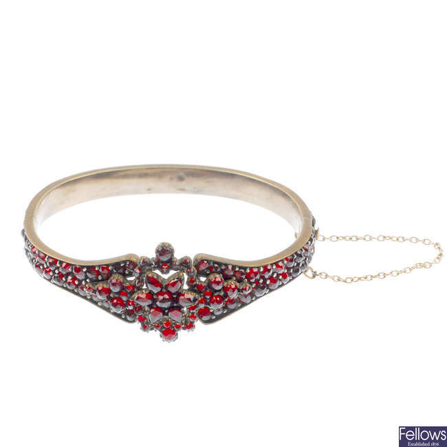 A late 19th century garnet and paste bangle.