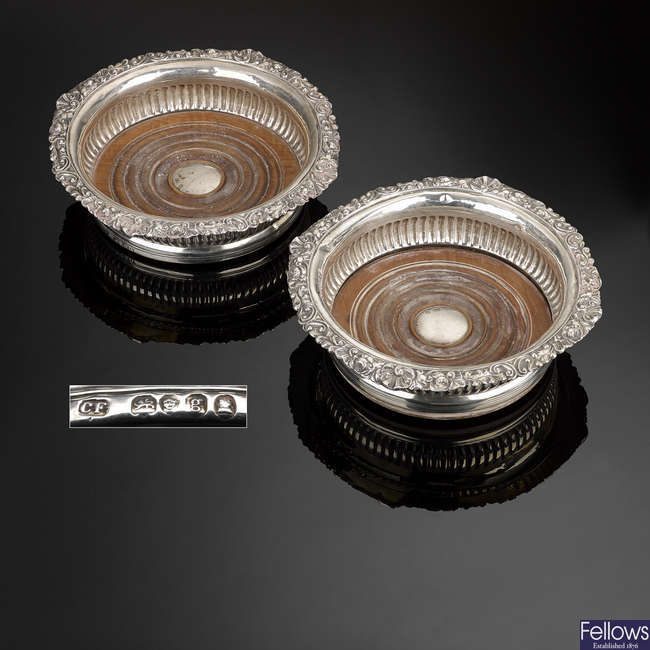 A pair of George IV silver mounted coasters.