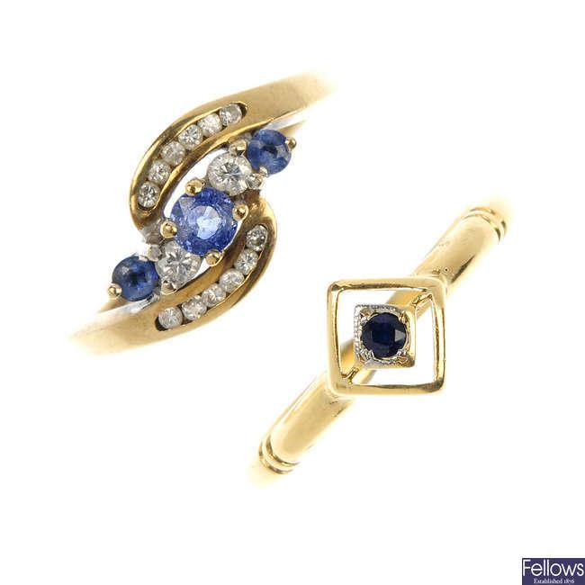 Two gold gem-set rings.
