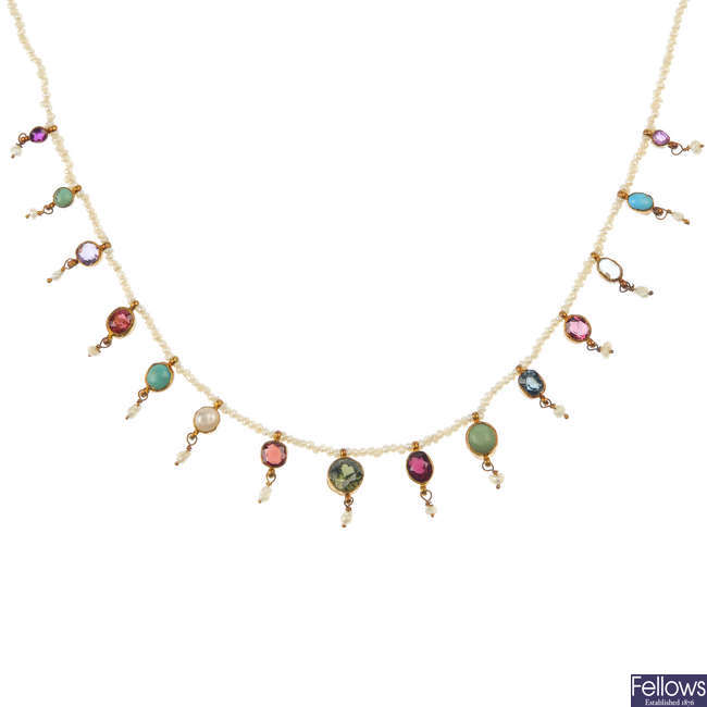 An early 20th century seed pearl and gem-set necklace.