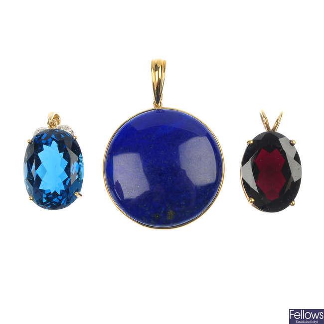 A selection of three gem-set pendants.