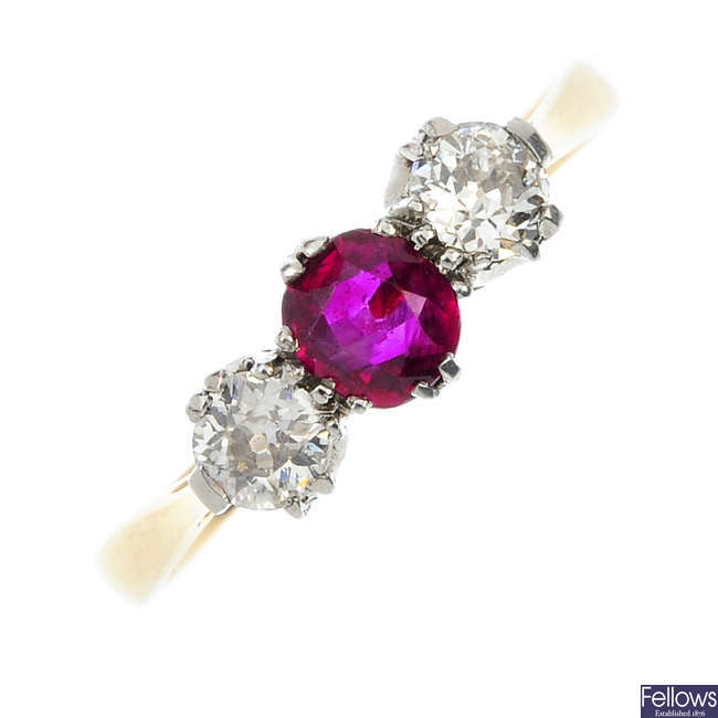 A mid 20th century 18ct gold and platinum ruby and diamond three-stone ring.