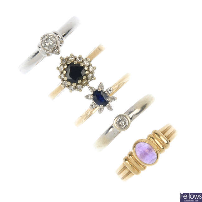 A selection of five 9ct gold gem-set dress rings.