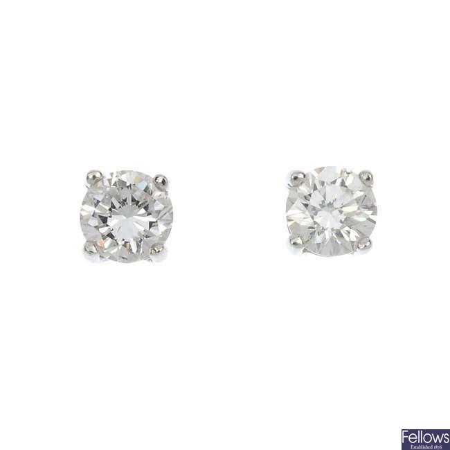 A pair of 18ct gold diamond single-stone ear studs.