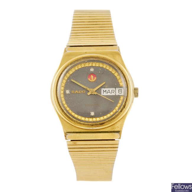 RADO - a gold plated automatic bracelet watch.