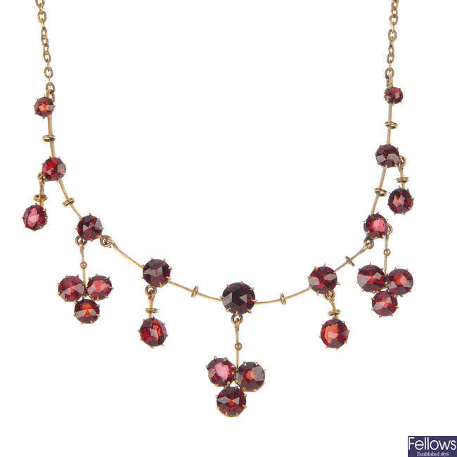 A late 19th century 9ct gold garnet necklace.