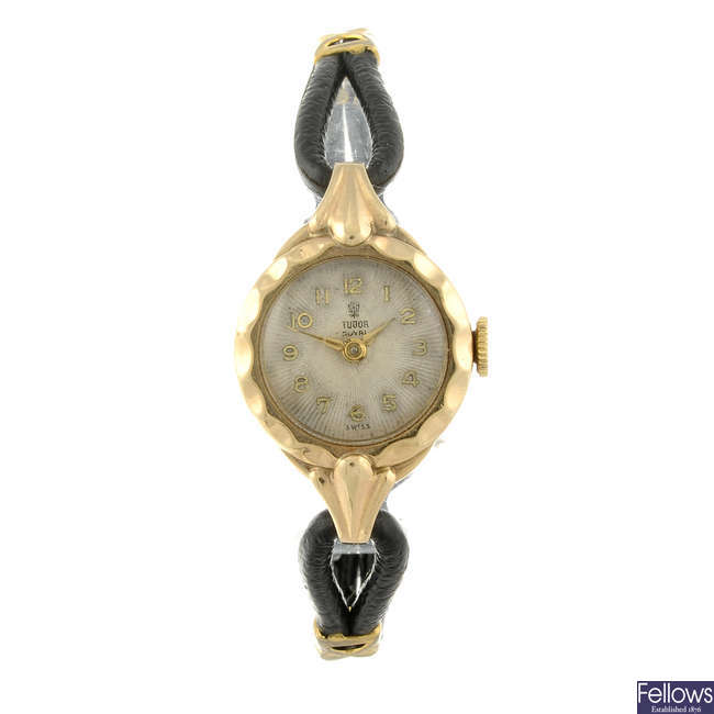 TUDOR ? a lady?s 9ct yellow gold wrist watch with two Omega watches.