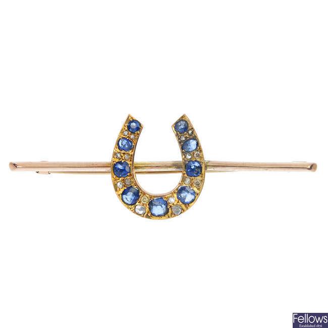 A sapphire and diamond horseshoe bar brooch.
