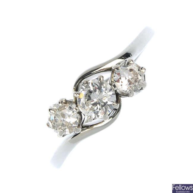 An 18ct gold diamond three-stone crossover ring.