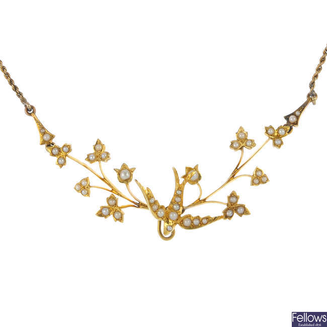 An early 20th century gold swallow necklace.