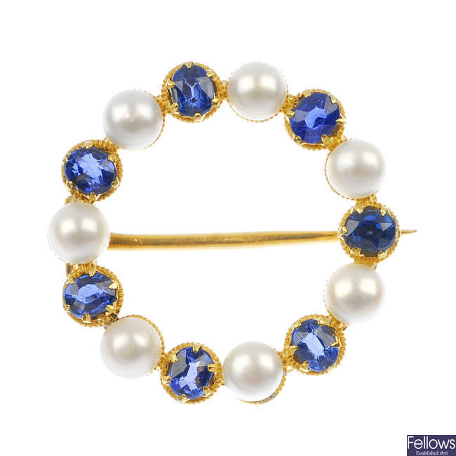 A sapphire and seed pearl wreath brooch.