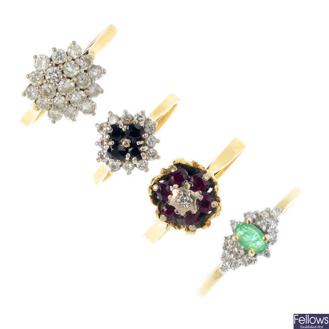 A selection of four gold gem-set rings.