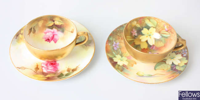Two hand painted Royal Worcester cabinet cups and saucers