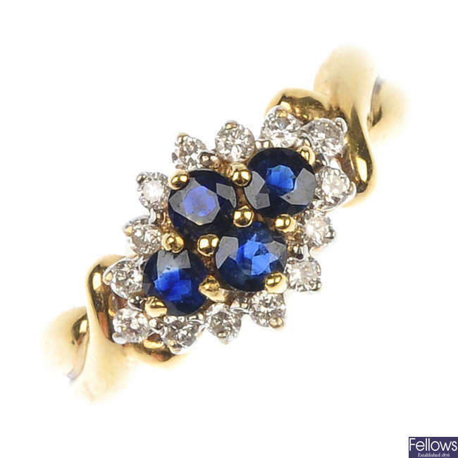 An 18ct gold sapphire and diamond cluster ring.