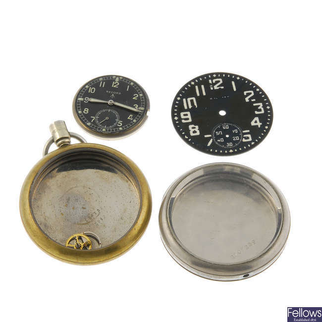 A mixed group of military watch parts.